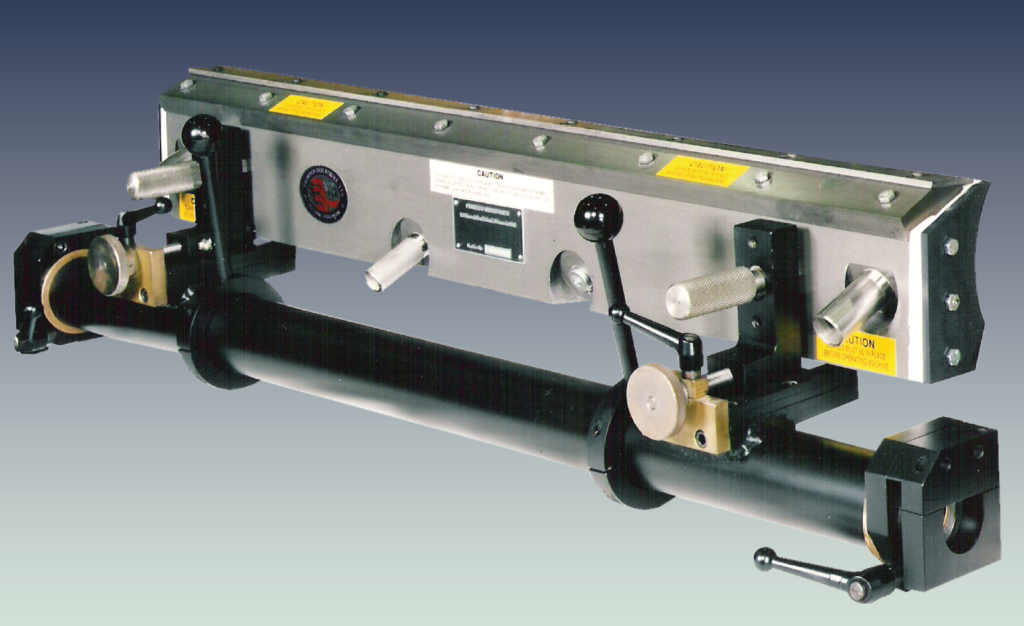 doctor blade system, adhesive applicator head with linear adjustment